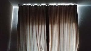 bedroom window with curtains and light passing through
